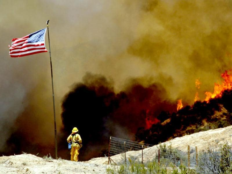 A firefighter watches a 1,400-acre wildfire northeast of Castaic, California. (AP)