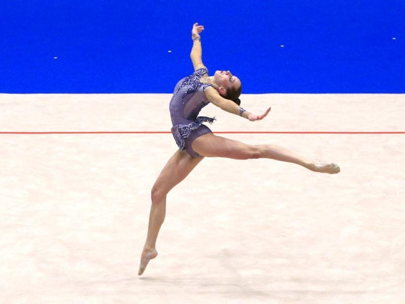 Katsiaryna Halkina from Belarus performs with the ball during the senior individual team competition as part of the 29th rythmic gymnastics European Championships held at the Stadthalle in Vienna. (AFP)