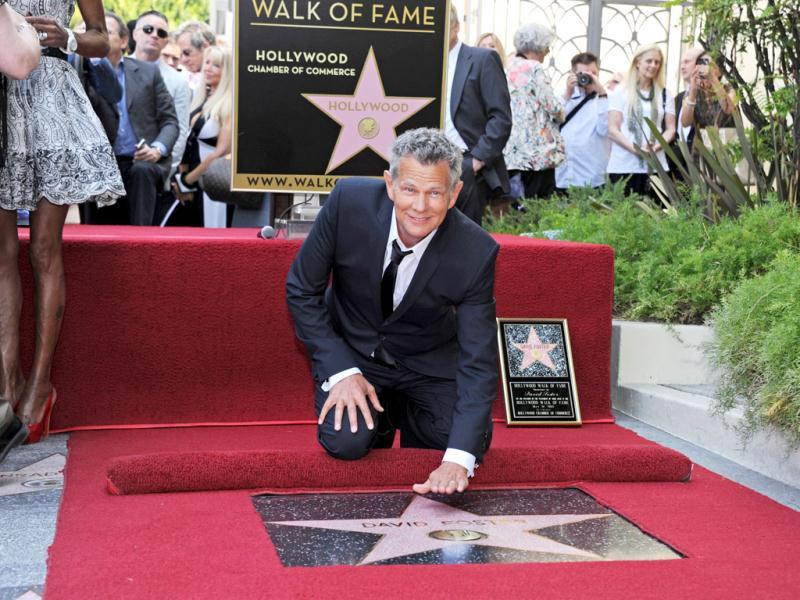 Canadian musician, record producer, composer, singer and songwriter David Foster attends a ceremony honoring him with a star on the Hollywood Walk of Fame in Hollywood, California. (AFP)