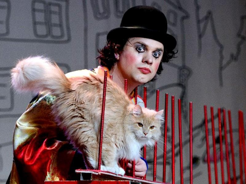 Vladimir Kouklatchev perfors with a cat during a show in the Moscow Cat Theatre, founded by his father, famous Russian clown Yuri Kouklatchev, shortly before the fall of the USSR. The theatre was recently re-opened after a top to bottom renovation. (AFP)