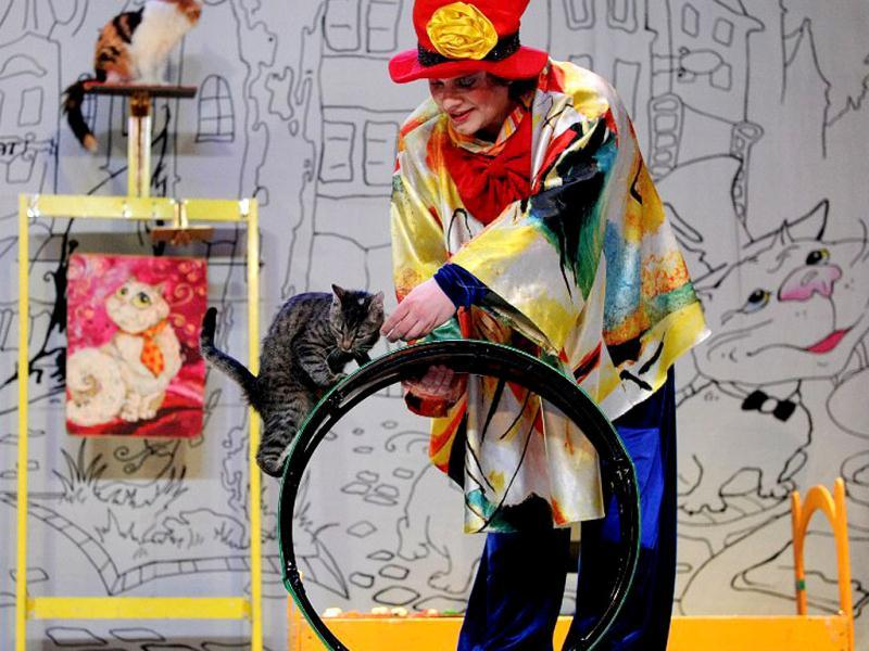 Vladimir Kouklatchev performs with a cat during a show in the Moscow Cat Theatre, founded by his father, famous Russian clown Yuri Kouklatchev, shortly before the fall of the USSR. The theatre was recently re-opened after a top to bottom renovation. (AFP)