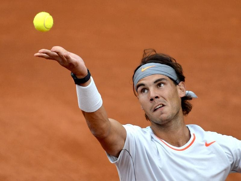 Spain's Rafael Nadal serves to Italy's Fabio Fognini during their French Tennis Open third round match at the Roland Garros stadium in Paris. AFP/Miguel Medina