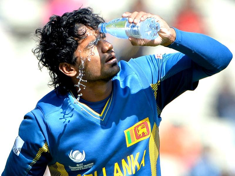 Sri Lanka's Kusal Perera pours water on his face during the warm-up cricket match ahead of the 2013 ICC Champions Trophy between India and Sri Lanka at Edgbaston in Birmingham. AFP/Andrew Yates