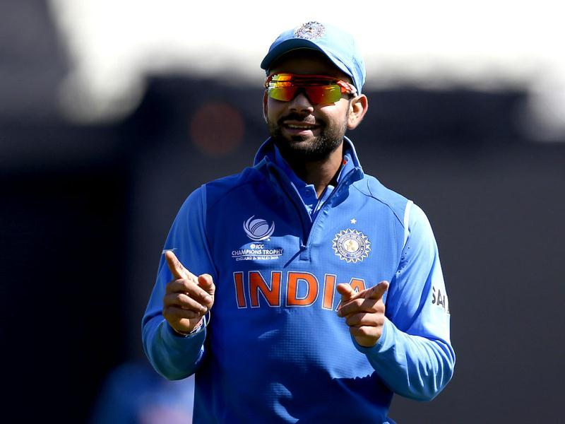 India's Virat Kohli reacts to cheering from supporters during the ICC Champions Trophy warm-up cricket match between India and Sri Lanka, at Edgbaston cricket ground in Birmingham. AP/Sang Tan