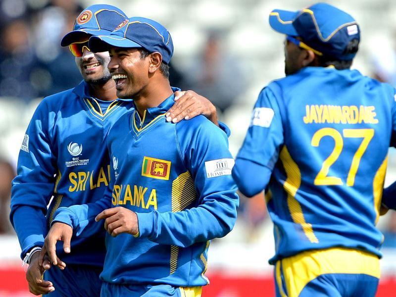 Sri Lanka's Nuwan Kulasekara (2nd L) celebrates after catching India's Rohit Sharma during the warm-up cricket match ahead of the 2013 ICC Champions Trophy at Edgbaston in Birmingham. AFP/Andrew Yates