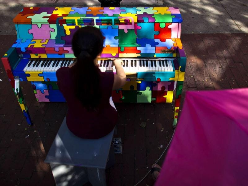 Kenatea Chavez Modrcin, 14, plays a piano of the organization Sing for Hope in a park in New York. (Reuters)