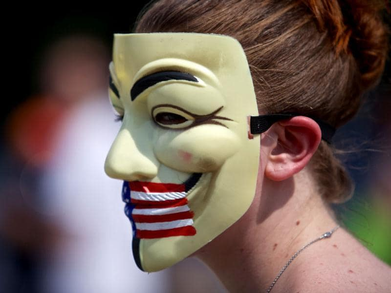 A women with a mask attends a mass rally in support for PFC Bradley Manning in Fort Meade, Maryland. (AFP)