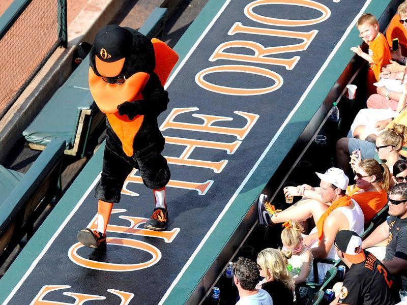 The Baltimore Orioles mascot performs on top of the dugout in the fourth inning of the game against the Detroit Tigers at Oriole Park at Camden Yards in Baltimore, Maryland. (AFP)