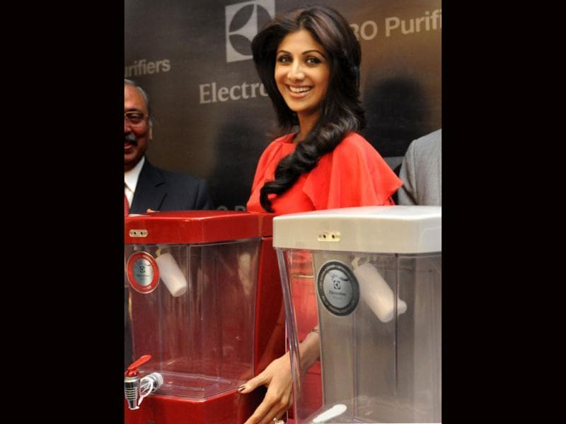 You love my smile? There. Capture that dear cameras! Shilpa Shetty during at a product launch in New Delhi on Saturday, June 01, 2013. (Photo courtesy: Sunil Saxena HT)