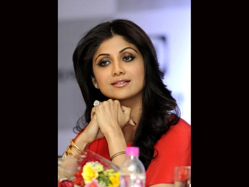 Shilpa Shetty seems to be wondering what her kid is upto back at home as she poses at an event. (Photo courtesy: Sunil Saxena HT)