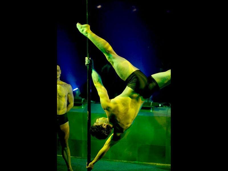 Participants perform during the third annual Pole Dancing Showcase at the Two Oceans Aquarium in Cape Town. This event shows off poledancing not as a sleazy activity in nightclubs, but as a form of exercise, entertainment and even sport. AFP PHOTO