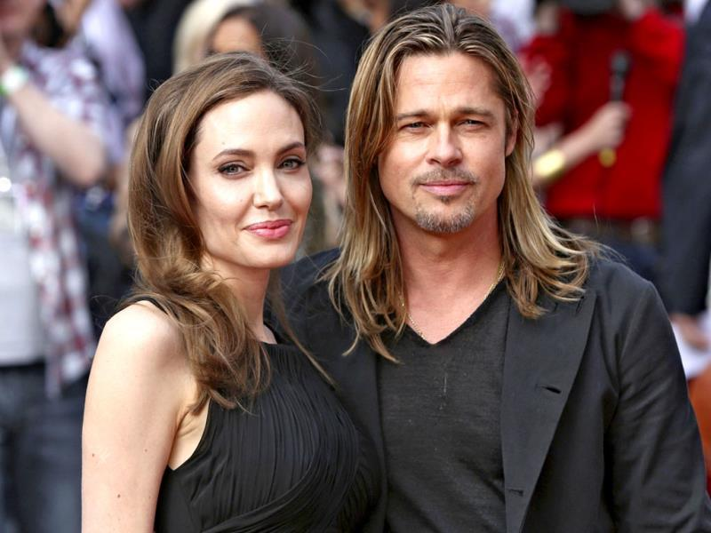Angelina Jolie poses with her husband Brad Pitt as they arrive for the world premiere of his film World War Z in London. Reuters Photo/Neil Hall