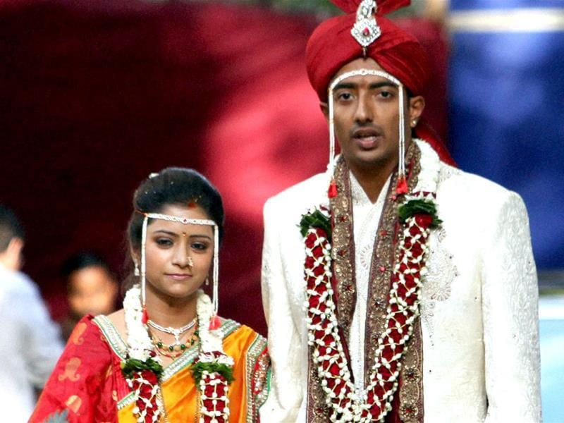 Cricketer Ankeet Chavan suspect in T20 spot-fixing scandal, poses with his wife Neha Sambari after their marriage in Mumbai. PTI Photo