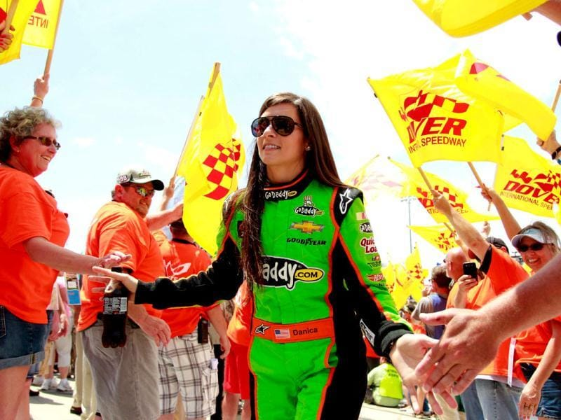 Danica Patrick, driver of the #10 GoDaddy Chevrolet, takes part in pre-race ceremonies for the NASCAR Sprint Cup Series FedEx 400 benefiting Autism Speaks at Dover International Speedway in Dover, Delaware. (AFP Photo)