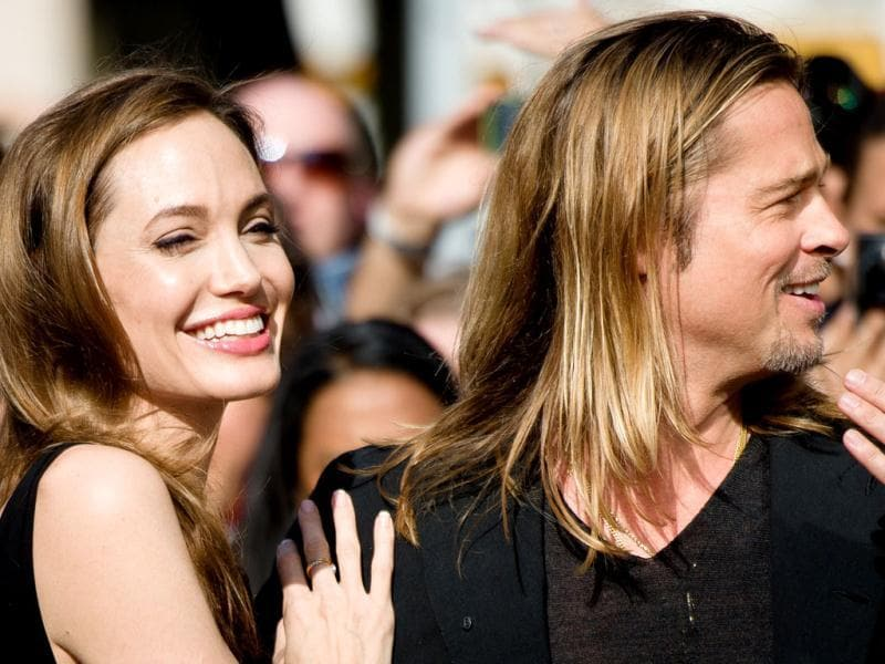 Jolie looked resplendent in her first outing after the double mastectomy. Occasion was cheering Brad Pitt during World War Z's UK premiere. (AFP Photo)