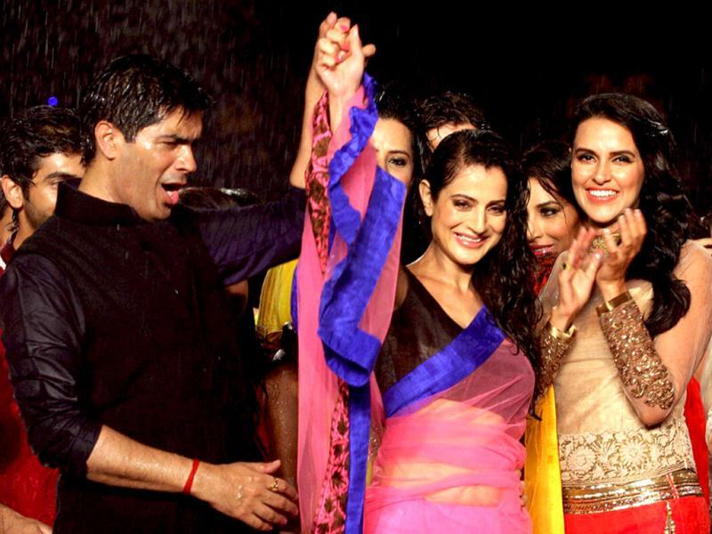 All wet Manish Malhotra cheers aloud! (PTI Photo)