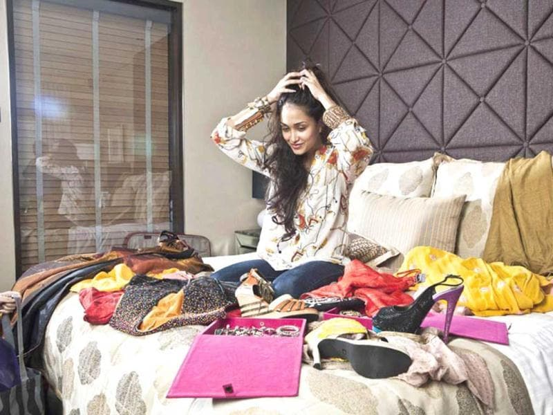 Confused? Jiah Khan looks more than happy to choose from her vast collection of accessories. (Photo credit: Aparna Jayakumar)