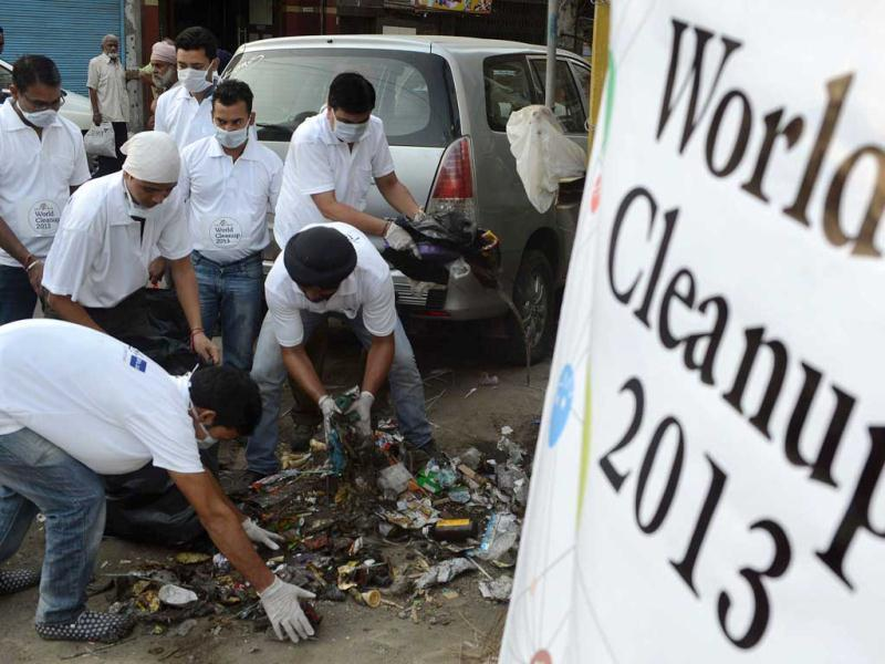 Volunteers pick up trash at the beginning of the cleanliness drive, 'World Cleanup-2013' outside the Jallianwala Bagh in Amritsar, on the eve of World Environment Day. India's cities are becoming more polluted and unhealthy, according to a new survey, showing growing concern about the impact of high economic growth on the environment. AFP Photo