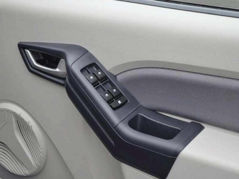 Top end variant features all four power windows. Thick door pads can also double up as an armrest.