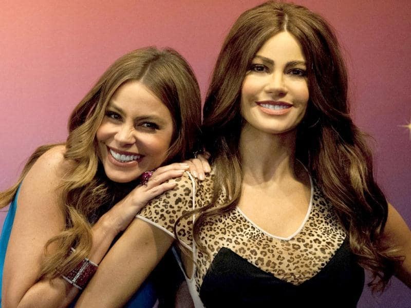 Colombian Emmy-nominated actress and model Sofia Vergara poses with one of her Madame Tussauds wax figures in Times Square in New York. (AFP Photo)