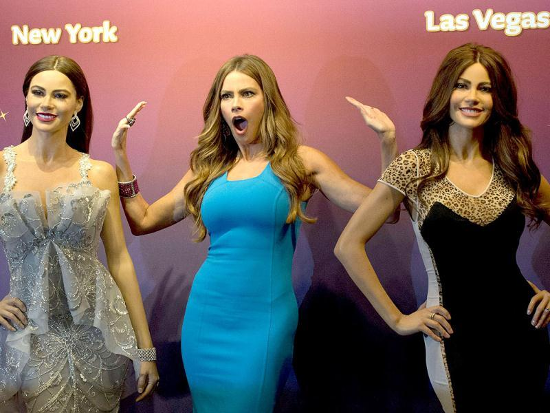 Colombian Emmy-nominated actress and model Sofia Vergara poses next to two of her Madame Tussauds wax figures in Times Square in New York. (AFP Photo)
