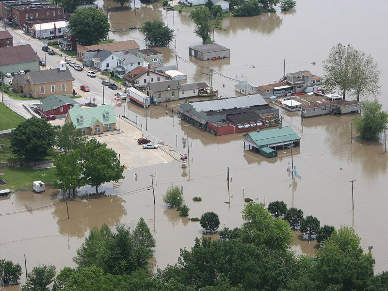 An aerial photo shows flooding at the intersection of Illinois Routes 100 and 3 in the center of Grafton, Illinois. (AP Photo)
