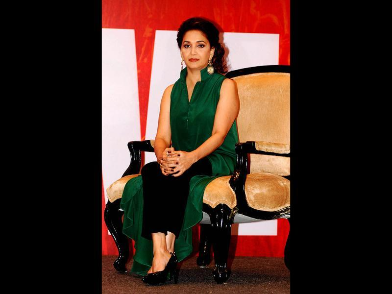 When we said evergreen, we meant it literally. We love Madhuri's oufit by the way. (AFP Photo)