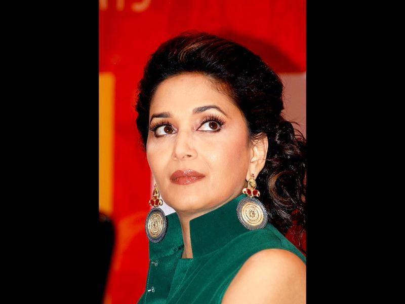 Madhuri looks up to reveal her dazzling earrings. (AFP Photo)