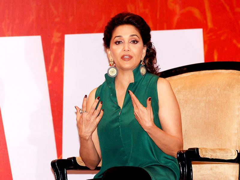 Madhuri in an animated discussion during the Gulaab Gang promotional event. (AFP Photo)