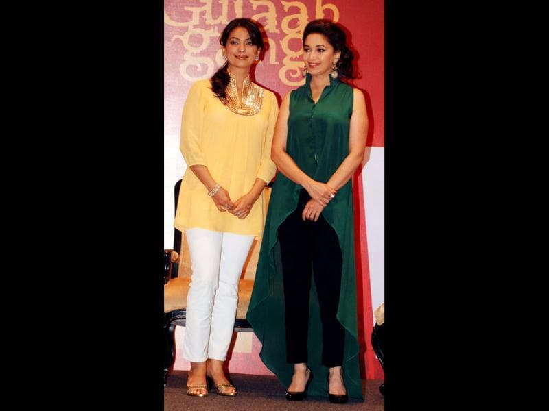 Evergreen actresses Madhuri Dixit and Juhi Chawla look radiant as ever as they come together for a promotional event for their upcoming film Gulaab Gang. Take a look at their pics. (AFP Photo)