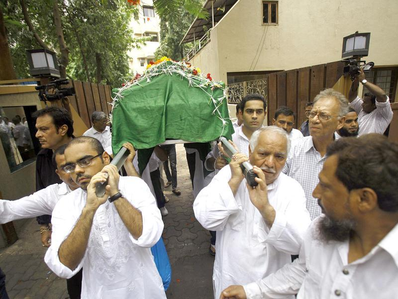 Jiah Khan's body is carried for burial after the last rites were performed. The 25-year-old actress was buried in a Juhu cemetery in Mumbai. (AP Photo)