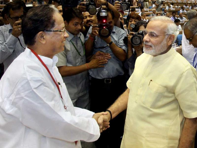 Gujarat chief minister Narendra Modi shake hands with Assam chief minister Tarun Gogoi during the chief ministers' conference on internal security in New Delhi. PTI Photo/Manvender Vashist