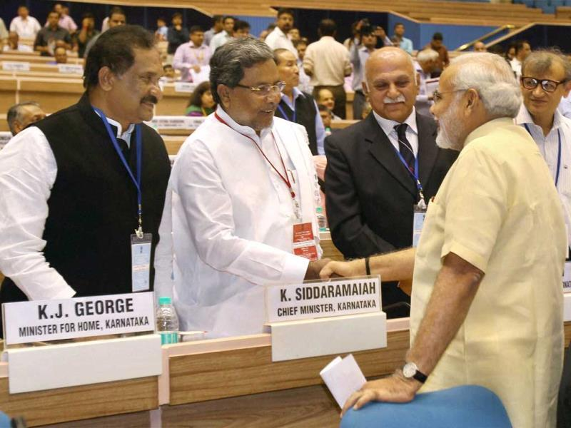 Gujarat chief minister Narendra Modi with Karnataka chief minister K Siddaramaiah during the chief ministers' conference on internal security in New Delhi. PTI Photo/Manvender Vashist