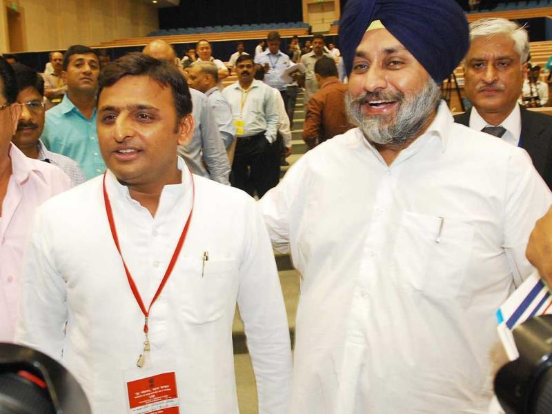 Punjab deputy chief minister Sukhbir Singh Badal meeting Uttar Pradesh chief minister Akhilesh Yadav during the chief minister's conference on internal security in New Delhi. UNI Photo
