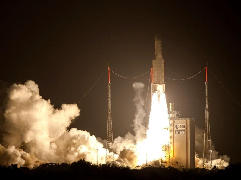 The Ariane 5 blasts off from the ground at the French Guyana European Spaceport of Kourou. (AFP Photo)