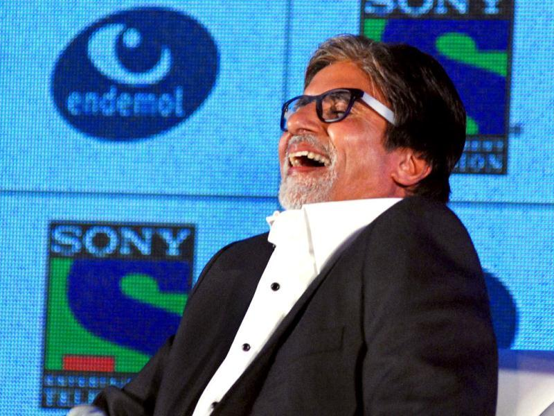 Laugh out loud: Amitabh captured in a light moment. (AFP Photo)