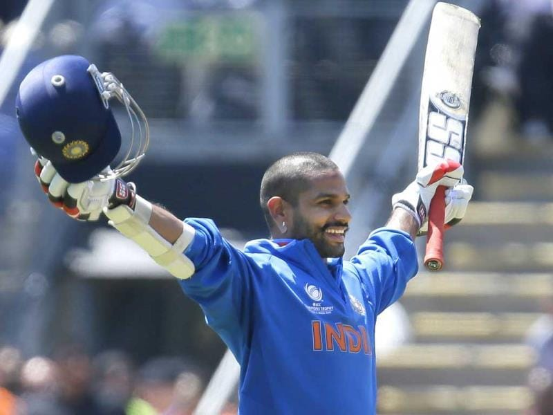 Shikhar Dhawan celebrates his maiden century in ODIs during their group stage ICC Champions Trophy cricket match against South Africa in Cardiff, Wales. AP photo