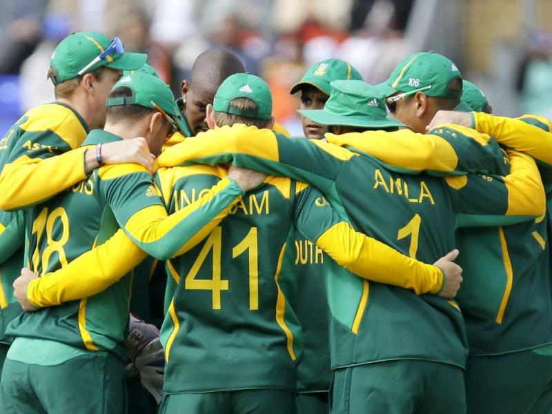South African cricket team form a huddle ahead of their group stage ICC Champions Trophy cricket match against India in Cardiff, Wales. AP photo