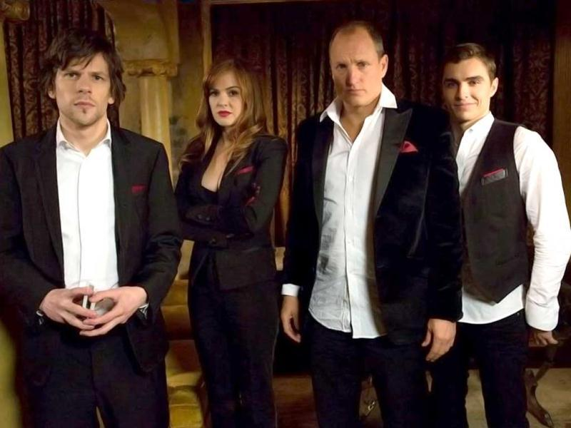 (L-R) Jesse Eisenberg, Isla Fisher, Woody Harrelson and Dave Franco play team of illusionists who pull off bank heists during their performances and reward their audiences with the money.