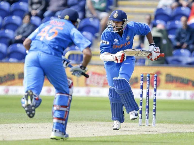 Rohit Sharma, left, and Shikhar Dhawan take a run during their group stage ICC Champions Trophy cricket match against South Africa in Cardiff, Wales. AP photo