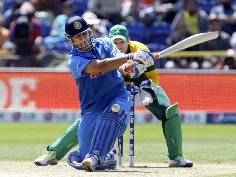 Mahendra Singh Dhoni misses a ball from South African bowler JP Duminy during their group stage ICC Champions Trophy cricket match in Cardiff, Wales. AP photo