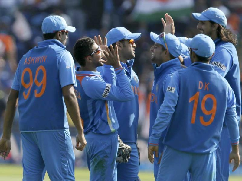 Ravindra Jadeja, second left, celebrates with teammates after taking a catch to dismiss South Africa's AB de Villiers during their group stage ICC Champions Trophy cricket match in Cardiff, Wales. AP photo