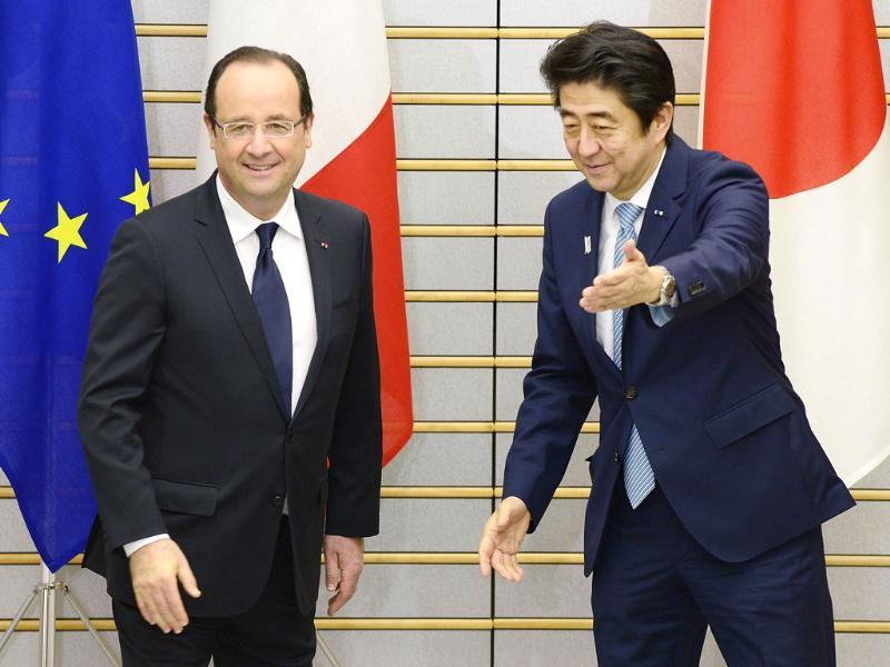 France's President Francois Hollande is welcomed by Japan's Prime Minister Shinzo Abe before their meeting at Abe's official residence in Tokyo. Hollande is in Japan for a three-day state visit. Reuters