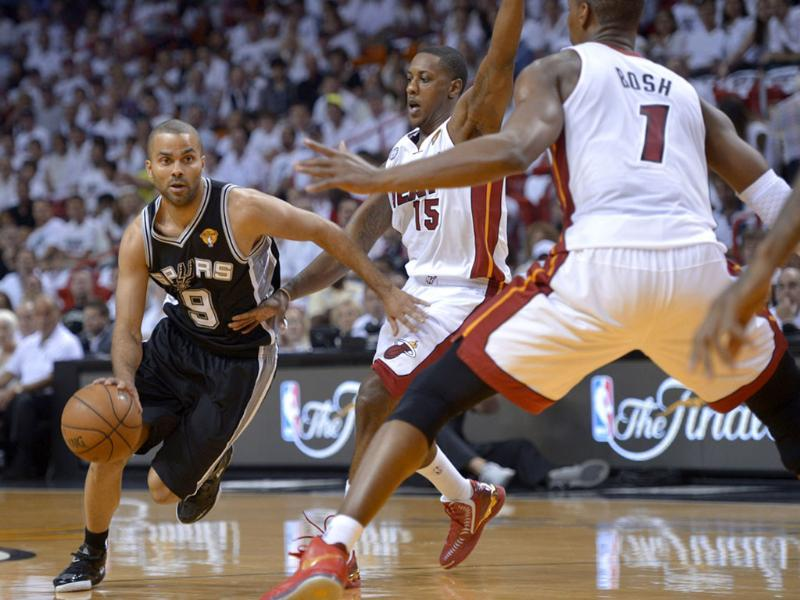 Tony Parker of the San Antonio Spurs moves the ball against the Miami Heat in the first half during Game 1 of the NBA Finals at American Airlines Arena in Miami, Florida. AFP