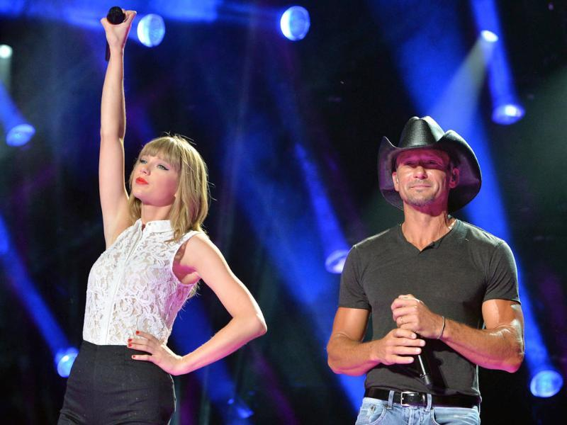 Taylor Swift and Tim McGraw perform during the 2013 CMA Music Festival in Nashville, Tennessee. AFP/Getty Images
