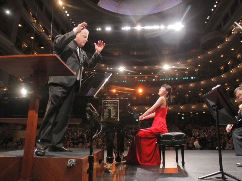 Fei-Fei Dong, age 22 of China, performs with the Fort Worth Symphony Orchestra under the direction of Leonard Slatkin during day one of the final round of the 14th Van Cliburn International Piano Competition, in the Bass Performance Hall in Fort Worth, Texas. AP