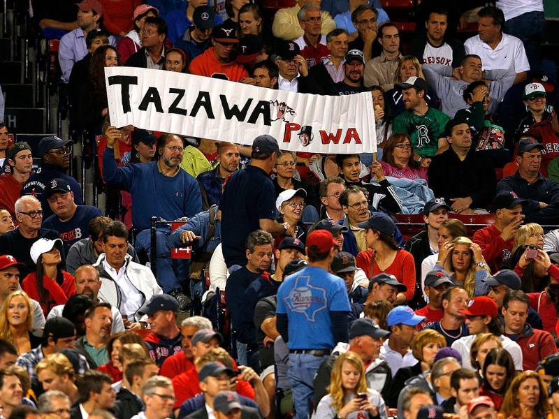 Fans of Junichi Tazawa of the Boston Red Sox show their support in the seventh inning against the Texas Rangers at Fenway Park in Boston, Massachusetts. AFP/Getty Images