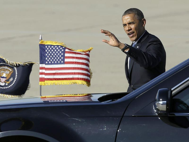President Barack Obama waves after arriving on Air Force One at Moffett Federal Airfield in Moffett Field, Calif. AP