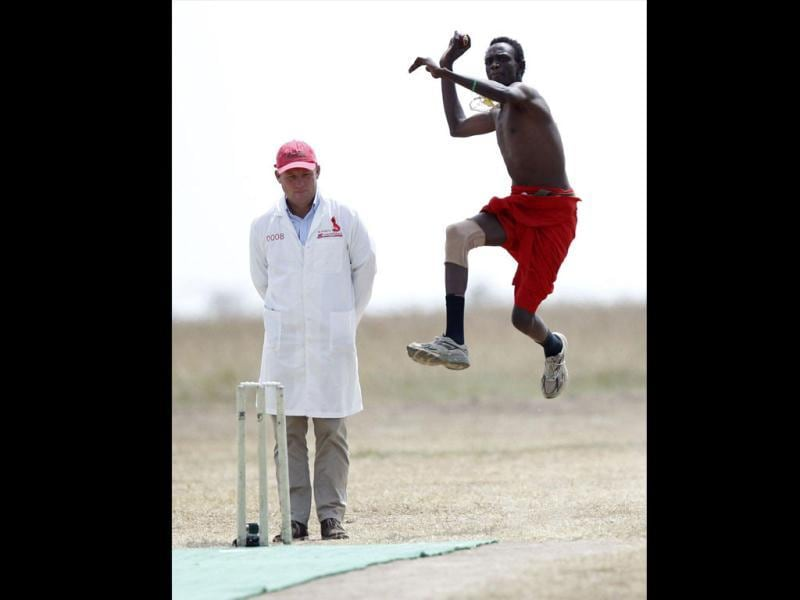 Daniel Ole Mamai of the Maasai Cricket Warriors bowls against the Ambassadors of Cricket from India plays in a T20 cricket match in Ol Pejeta conservency in Laikipia national park. REUTERS