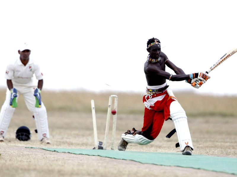Sonyanga Olengais, captain of the Maasai Cricket Warriors, plays a shot against the Ambassadors of Cricket from India in a T20 cricket match in Ol Pejeta conservency in Laikipia national park. Agencies